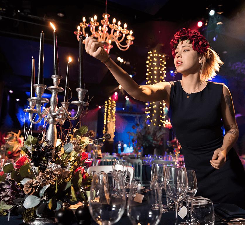 Lady lighting Christmas candles