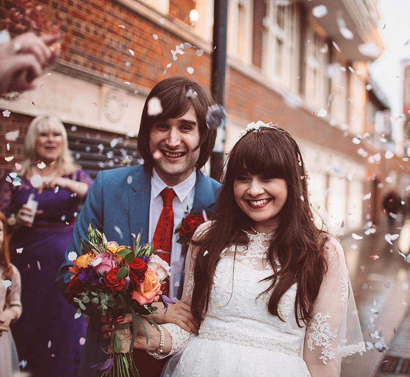 Groom next to Bride with bouquet